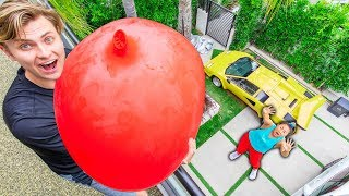 DROPPING 100LBS WATER BALLOON ON HER!! (GONE WRONG)