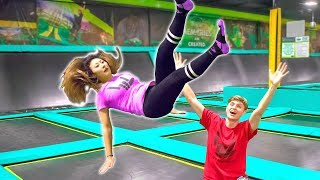 TEACHING HER TO BACKFLIP ON TRAMPOLINE!! (GONE WRONG)